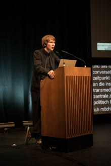 "Picture of Kristoffer Gansing announcing the Keynote Conversation ""Anxious to Act"""