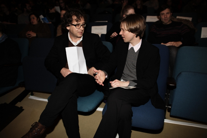 """Picture of Bernd Scherer (left) and Kristoffer Gansing (right) talking before """"afterglow effects: transmediale 2014 opening ceremony"""""""